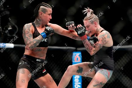 Bec Rawlings, Ashlee Evans-Smith. Bec Rawlings, right, of Australia, fights Ashlee Evans-Smith during the third round women's flyweight mixed martial arts bout at UFC 223, in New York. Evans-Smith won the fight