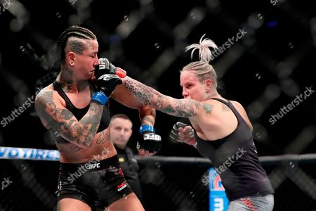 Bec Rawlings, Ashlee Evans-Smith. Bec Rawlings, right, of Australia, punches Ashlee Evans-Smith during the third round women's flyweight mixed martial arts bout at UFC 223, in New York. Evans-Smith won the fight