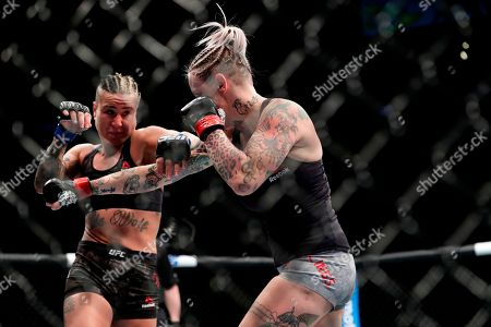Stock Picture of Bec Rawlings, Ashlee Evans-Smith. Ashlee Evans-Smith, left, fights Bec Rawlings, of Australia, during the first round of a women's flyweight mixed martial arts bout at UFC 223, in New York. Evans-Smith won the fight