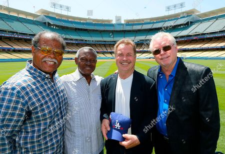 Reggie Smith, Manny Mota, Ron Cey, Bill Russell. Former Los Angeles Dodgers players, from left, Reggie Smith, Manny Mota, Ron Cey and Bill Russell pose for a picture after Baseball Commissioner Rob Manfred announced that Dodger Stadium will host the All-Star Game in 2020, at a news conference in Los Angeles on