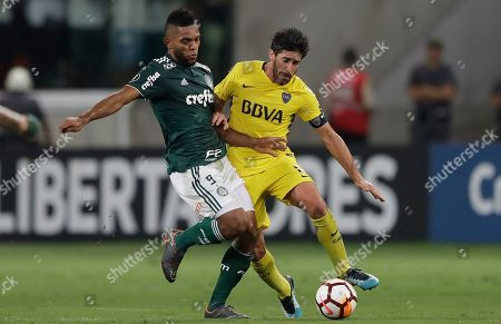 Miguel Borja of Brazil's Palmeiras, left, fights for the ball with Pablo Javier Perez of Argentina's Boca Juniors, during a Copa Libertadores soccer match in Sao Paulo, Brazil