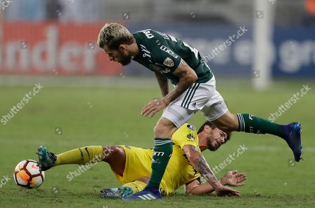 Lucas Lima of Brazil's Palmeiras runs to get control of the ball after Pablo Javier Perez of Argentina's Boca Juniors falls on the pitch, during a Copa Libertadores soccer match in Sao Paulo, Brazil
