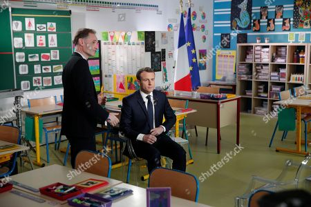 French President Emmanuel Macron (C) arrives inside the classroom prior his interview by French journalist Jean-Pierre Pernaut organized by French TV channel TF1 at the school in Berd'huis, west of Paris, France, 12 April 2018.