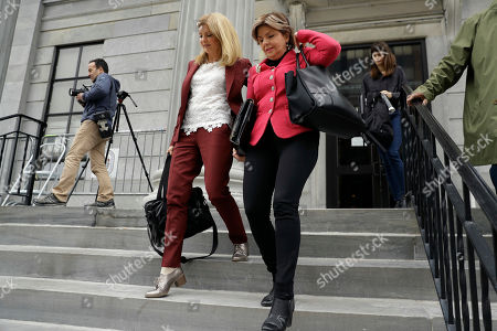 Attorneys Gloria Allred, left, and Lisa Bloom arrive to talk with the media during a break in Bill Cosby's sexual assault trial, at the Montgomery County Courthouse in Norristown, Pa
