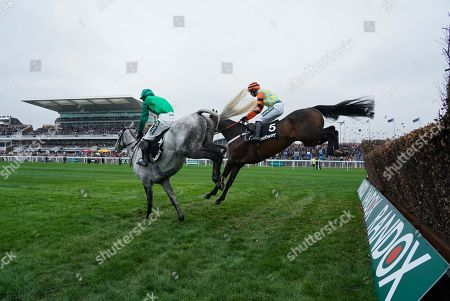 Bristol De Mai trained by Nigel Twiston-Davies and ridden by Daryl Jacob and Might Bite trained by Nicky Henderson and ridden by Nico de Boinville clears in the Betway Bowl Chase (Grade 1)
