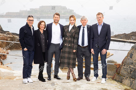 Thomas Bezucha, Paula Mazur, Glen Powell, Lily James, Tom Courtenay and Graham Broadbent attend the photocall for 'The Guernsey Literary and Potato Peel Pie Society' in Guernsey.