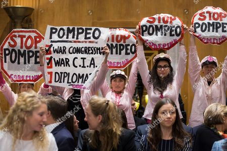 Protesters hold signs opposing CIA Director Mike Pompeo (not pictured) before the start of the Senate Foreign Relations Committee hearing on the nomination of Pompeo to be Secretary of State, on Capitol Hill in Washington, DC, USA, 12 April 2018. If confirmed, Pompeo would fill the vacancy left after US President Donald J. Trump fired Rex Tillerson.