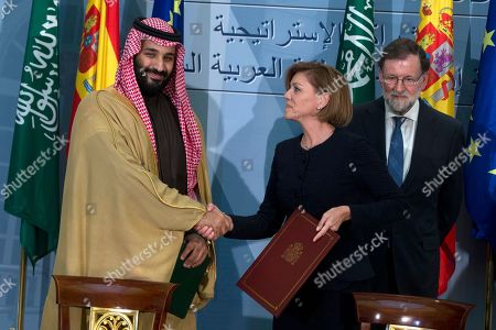 Stock Picture of Mariano Rajoy, Prince Mohammed bin Salman, Maria Dolores Cospedal. Saudi Arabia Crown Prince Mohammed bin Salman, left and Spain's Defense Minister Maria Dolores Cospedal shake hands after signing bi-lateral agreements in the presence of Spain's Prime Minister Mariano Rajoy, right, at the Moncloa Palace in Madrid, Spain, . Prince Mohammed bin Salman is on an official visit to Spain