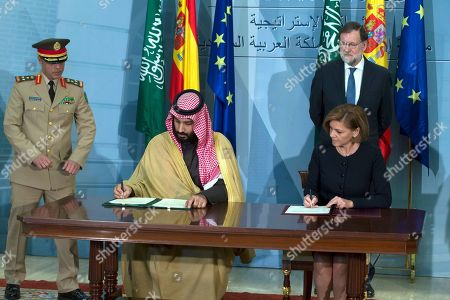 Stock Image of Mariano Rajoy, Prince Mohammed bin Salman, Maria Dolores Cospedal. Saudi Arabia Crown Prince Mohammed bin Salman, left and Spain's Defense Minister Maria Dolores Cospedal sign bi-lateral agreements in the presence of Spain's Prime Minister Mariano Rajoy at the Moncloa Palace in Madrid, Spain, . Prince Mohammed bin Salman is on an official visit to Spain