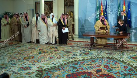 Mariano Rajoy, Prince Mohammed bin Salman, Maria Dolores Cospedal. Saudi Arabia Crown Prince Mohammed bin Salman, left and Spain's Defense Minister Maria Dolores Cospedal sign bi-lateral agreements in the presence of Spain's Prime Minister Mariano Rajoy at the Moncloa Palace in Madrid, Spain, . Prince Mohammed bin Salman is on an official visit to Spain