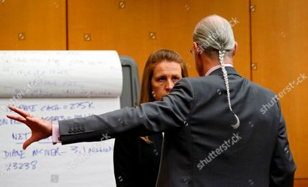 Tex and Diane McIver's masseuse, Annie Anderson talks with defense attorney Bruce Harvey before she was sworn in to testify during the Tex McIver murder trial at the Fulton County Courthouse in Atlanta on