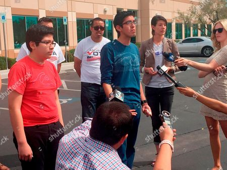 Eric Avelar-Gomez, Ricardo Avelar-Gomez, Bliss Requa-Trautz. Eric Avelar-Gomez, front left, Ricardo Avelar-Gomez, center, and Bliss Requa-Trautz right, speak outside the Las Vegas office of U.S. Citizenship and Immigration Services, to call on immigration authorities to release from custody Mexican national Cecilia Gomez. Gomez was sent a notice to appear in court and, after she did not show for the court date, was then sent a notice of deportation, said Lori Haley, spokeswoman for U.S. Immigration and Customs Enforcement. But Gomez's family said she didn't find out about the correspondence until nearly 20 years later, when she was arrested on March 27 after she walked into the U.S. Citizen and Immigration Services office in Las Vegas to apply for permanent residency