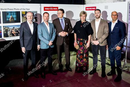 (L-R) Nominees of the World Press Photo Award Picture of the Year: Patrick Brown, Adam Ferguson, Ivor Prickett and Ronaldo Schemidt pose for a photo with Dutch Prince Constantijn (3-L) and Princess Laurentien (3-R) prior to the World Press Photo Awards ceremony in Amsterdam, The Netherlands, 12 April 2018.
