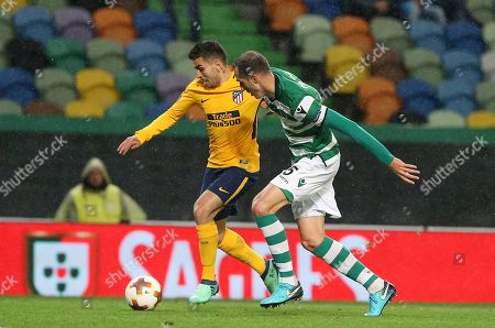 Atletico's Angel Correa, left, challenges for the ball with Sporting's Fabio Coentrao during the Europa League quarterfinal second leg soccer match between Sporting CP and Atletico Madrid at the Alvalade stadium in Lisbon