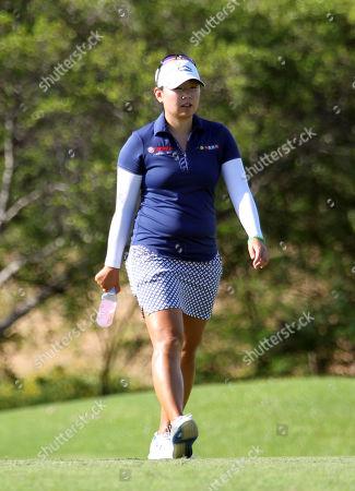 Mina Harigae walks the 6th hole during the first round of the LPGA LOTTE Championship at the Ko Olina Golf Club in Kapolei , HI - Michael Sullivan/CSM