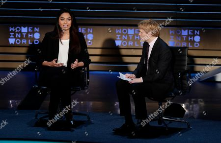 Ambra Battilana, Ronan Farrow. Ronan Farrow, right, listens as Italian model Ambra Battilana speaks at the ninth annual Women in the World Summit, in New York
