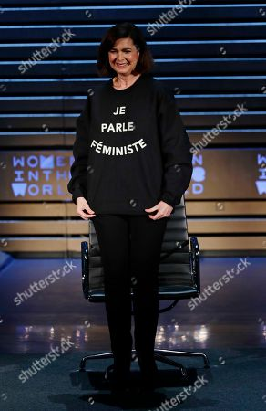 Laura Boldrini shows off a shirt as she speaks at the ninth annual Women in the World Summit, in New York
