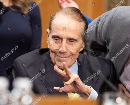Former United States Senate Majority Leader Bob Dole (Republican of Kansas) waves as he arrives to endorse the nomination of CIA Director Mike Pompeo to be US Secretary of State before the US Senate Committee on Foreign Relations on Capitol Hill in Washington, DC.