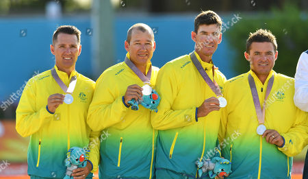 Barrie Lester, Brett Wilkie, Nathan Rice and Aron Sherriff of Australia are seen with their silver medals after losing the Lawn Bowl's Men's Fours Gold Medal match against the Scotland team of Ronald Duncan, Derek Oliver, Paul Foster and Alexander Marshall at the XXI Commonwealth Games at the Broadbeach Bowls Club on the Gold Coast, Australia, 13 April 2018.