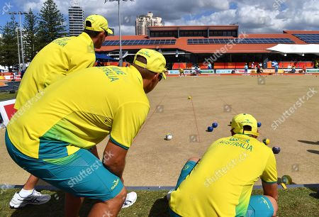Nathan Rice, Brett Wilkie, Barrie Lester watch Aron Sherriff of Australia bowl during the Lawn Bowl's Men's Fours Gold Medal match against the Scotland team of Ronald  Duncan, Derek Oliver, Paul Foster and Alexander Marshall at the XXI Commonwealth Games at the Broadbeach Bowls Club on the Gold Coast, Australia, 13 April 2018.