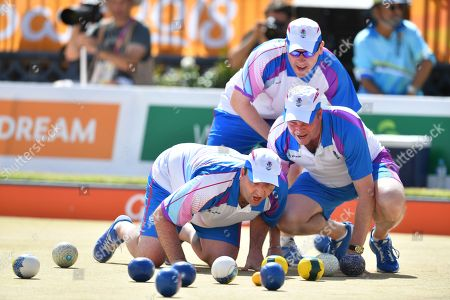 The Scotland team of Derek Oliver, Ronald Duncan and Paul Foster are seen during the gold medal against Barrie Lester, Brett Wilkie, Nathan Rice and Aron Sherriff of Australia during the Lawn Bowl's Men's Fours Gold Medal match of the XXI Commonwealth Games at the Broadbeach Bowls Club on the Gold Coast, Australia, 13 April 2018.