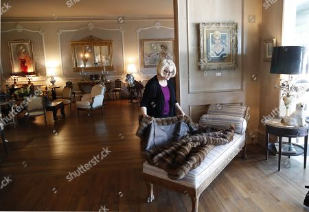 A curator inspects a fur coat belonging to the late Hungarian-American actress Zsa Zsa Gabor at the 'Hello Dal-ling: The Estate of Zsa Zsa Gabor' auction by Heritage Auctions at the actress' residence in Bel Air, California, USA, 12 April 2018. The live auction will take place 14 April 2018.