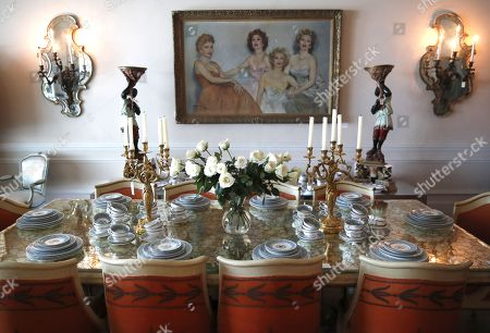 A dinner room table and settings and a Fried Pal portrait of Zsa Zsa Gabor, her sisters and mother are displayed at the 'Hello Dal-ling: The Estate of Zsa Zsa Gabor' auction by Heritage Auctions at the late actress residence in Bel Air, California, USA, 12 April 2018. The live auction will take place 14 April 2018.