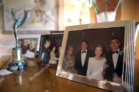 Photographs and an award belonging to the late Hungarian-American actress Zsa Zsa Gabor are displayed at the 'Hello Dal-ling: The Estate of Zsa Zsa Gabor' auction by Heritage Auctions at the actress' residence in Bel Air, California, USA, 12 April 2018. The live auction will take place 14 April 2018.