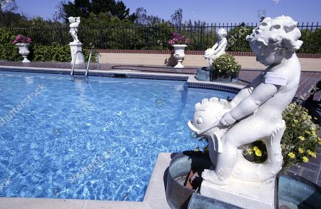 Stock Photo of Cast stone figural fountain with four-part copper jardinieres belonging to the late Hungarian-American actress Zsa Zsa Gabor are displayed around the pool at the 'Hello Dal-ling: The Estate of Zsa Zsa Gabor' auction by Heritage Auctions at the actress' residence in Bel Air, California, USA, 12 April 2018. The live auction will take place 14 April 2018.