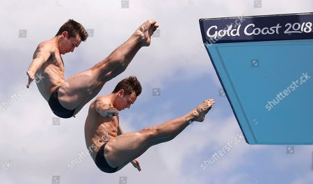 England's Thomas Daley, right, and Daniel Goodfellow make a dive during the men's synchronised 10m platform final at the Aquatics Centre during the 2018 Commonwealth Games on the Gold Coast, Australia