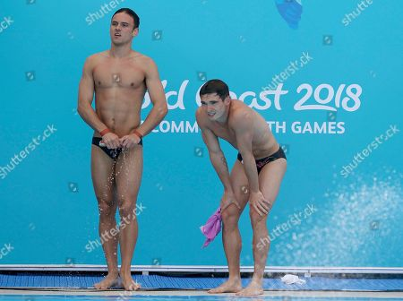 England's Thomas Daley, right, and Daniel Goodfellow wait for the score of their final dive during the men's synchronised 10m platform final at the Aquatics Centre during the 2018 Commonwealth Games on the Gold Coast, Australia