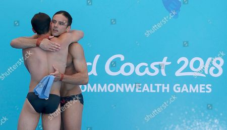 England's Thomas Daley, right, and Daniel Goodfellow hug after their final dive during the men's synchronised 10m platform final at the Aquatics Centre during the 2018 Commonwealth Games on the Gold Coast, Australia