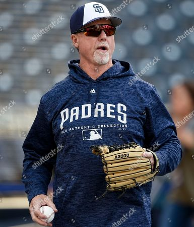 San Diego Padres bench coach Mark McGwire looks on during batting practice prior to a baseball game against the San Francisco Giants in San Diego