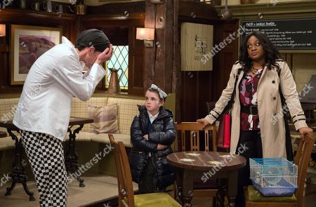 Stock Photo of Ep 8124 Monday 16th April 2018 Jessie, as played by Sandra Marvin, orders Marlon Dingle, as played by Mark Charnock, to explain everything to April Windsor's, as played by Amelia Flanagan, class about the gerbil, secretly enjoying winding him up.
