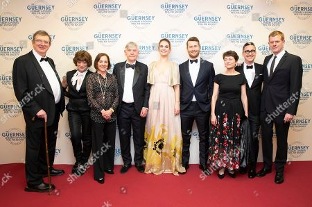 Stock Image of Mike Newell, Bernice Stegers, Paula Mazur, Tom Courtenay, Lily James, Glen Powell, Annie Barrows, Thomas Bezucha and Graham Broadbent