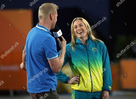 Australia's Sally Pearson speaks to a television person at Carrara Stadium during the Commonwealth Games on the Gold Coast, Australia, . The 31-year-old 100m hurdler had earlier pulled out of the Commonwealth Games because of injury