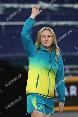 Australia's Sally Pearson waves to the crowd at Carrara Stadium during the Commonwealth Games on the Gold Coast, Australia, . The 31-year-old 100m hurdler had earlier pulled out of the Commonwealth Games because of injury