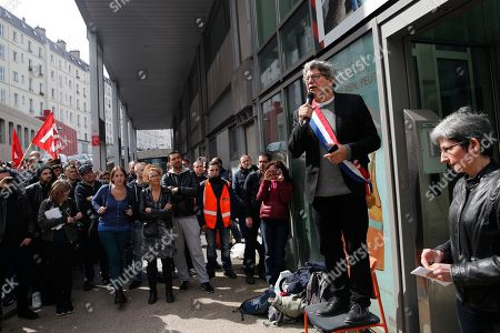 French far-left parliament member Eric Coquerel, second right, speaks to striking rail workers listen to speeches at the Gare de Lyon train station in Paris, . Rail workers resumed a strike Friday that is set to disrupt travel off-and-on through June. But the number of striking workers is down from previous actions, and international trains were largely maintained