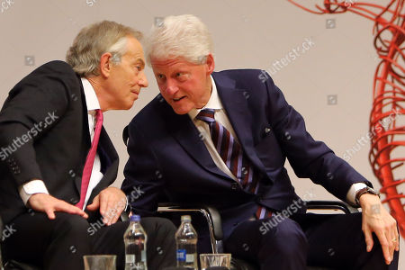 Former British Prime Minister Tony Blair and former US President Bill Clinton at Queen's University Belfast