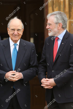 Former US Senator George Mitchell jokes with Former Sinn Fein leader Gerry Adams during a photo call outside at Queen's University Belfast
