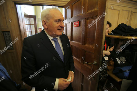 Former Taoiseach Mr Bertie Ahern follows Senator George Mitchell at Queen's University Belfast