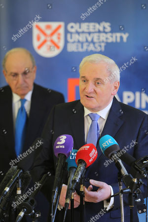 Former Taoiseach Mr Bertie Ahern speaks while Senator George Mitchell and former British Government adviser Jonathan Powell listens on during a press conference at Queen's University Belfast