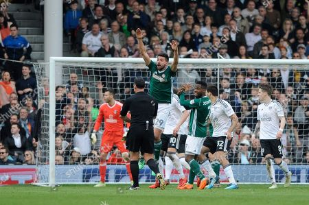 The Brentford players react after nothing is given by referee Neil Swarbrick after believing Stefan Johansen of Fulham handled the ball during the Sky Bet Championship match between Fulham and Brentford at Craven Cottage in London. 14 Apr 2018