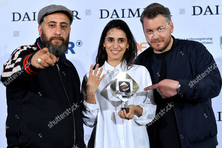 Stock Photo of (L-R) Kia Khodr Ramadan, Maryam Zaree and Marvin Kren pose with the Grimme-Preis award for the film '4 Blocks' at the 54th Grimme Award ceremony in Marl, Germany, 13 April 2018. The prize is a German television award given in different categories.