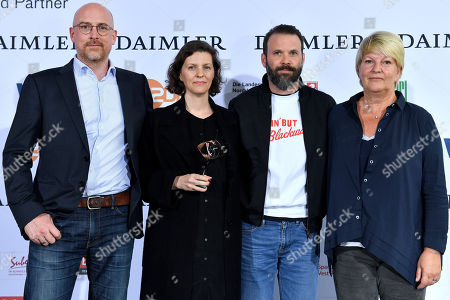 (L-R) Germans production designer Udo Kramer, writer Jantie Friese, director Baran bo Odar and casting deirector Simone Baer pose with the Grimme-Preis award for the German television series 'Dark' of video-on-demand provider Netflix at the 54th Grimme Award ceremony in Marl, Germany, 13 April 2018. The prize is a German television award given in different categories.