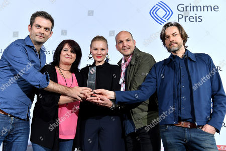 (L-R) Germans authors Christian Lex, Angelika Schwarzhuber, actress Rosalie Thomass, producer Nils Duenker and Swiss director Hans Steinbichler pose with the audience award for the film 'Eine unerhoerte Frau' at the 54th Grimme Award ceremony in Marl, Germany, 13 April 2018. The prize is a German television award given in different categories.
