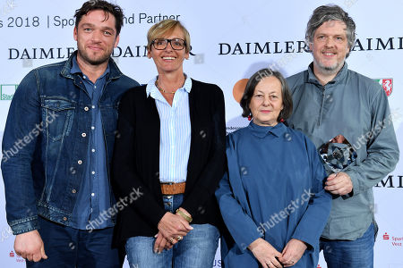 German (L-R) actor Ronald Zehrfeld, production designer Petra Heim, author Heide Schwochow and director Matthias Glasner pose with the Grimme-Preis award for 'Landgericht' (lit: district court) at the 54th Grimme Award ceremony in Marl, Germany, 13 April 2018. The prize is a German television award given in different categories.