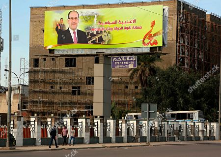 Stock Image of A campaign poster of former Iraqi Prime Minister Nouri al-Maliki in Baghdad, Iraq. Politicians eager to shape the country's future began campaigning in earnest well in advance of the official campaign period that began April 14. It will be Iraq's fourth parliamentary elections since the 2003 U.S.-led invasion that rem oved Saddam Hussein from power. According to the Independent Electoral Commission, nearly 7,000 candidates will vie for 329 seats on May 12