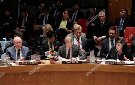 Karen Price, British ambassador to the United Nations, right, speaks during a Security Council meeting as Vassily Nebenzia, left, Russia's ambassador to the United Nations, and Olof Skoog, Swedish ambassador to the UN, center, listen, at United Nations headquarters