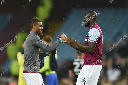 Lewis Grabban of Aston Villa shakes hands with Christopher Samba of Aston Villa